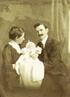 Photograph of a husband and wife and their baby.