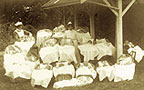 Photograph of babies and nurses at a Karitane Hospital.