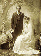 Photograph of a couple at their wedding.