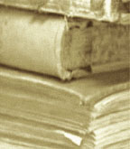 Photograph of a stack of registers dating from 1841 to 1883 including a second world war death register.